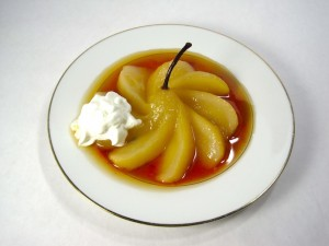 Sliced poached pear with whipped cream