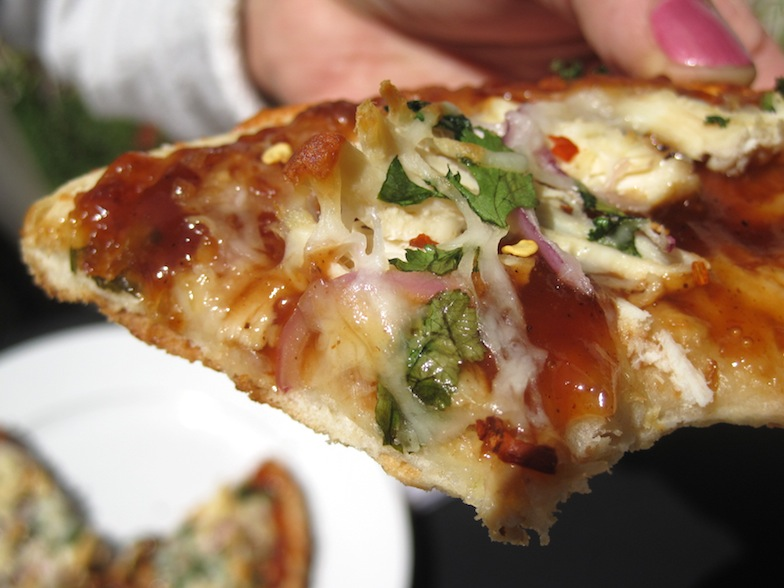 Barbecue Chicken Pizza close up with bite missing