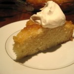 Piece of Cardamom Pear Cake with fresh Whipped Cream