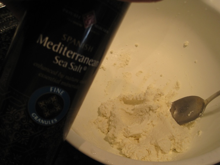 Adding sea salt to fresh goat cheese