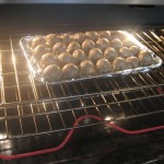 Meatballs cooking in the oven
