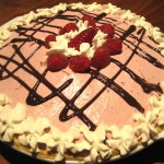 Raspberry Cream Pie with Chocolate Ganache and Whipped Cream