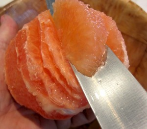 cutting grapefruit segments