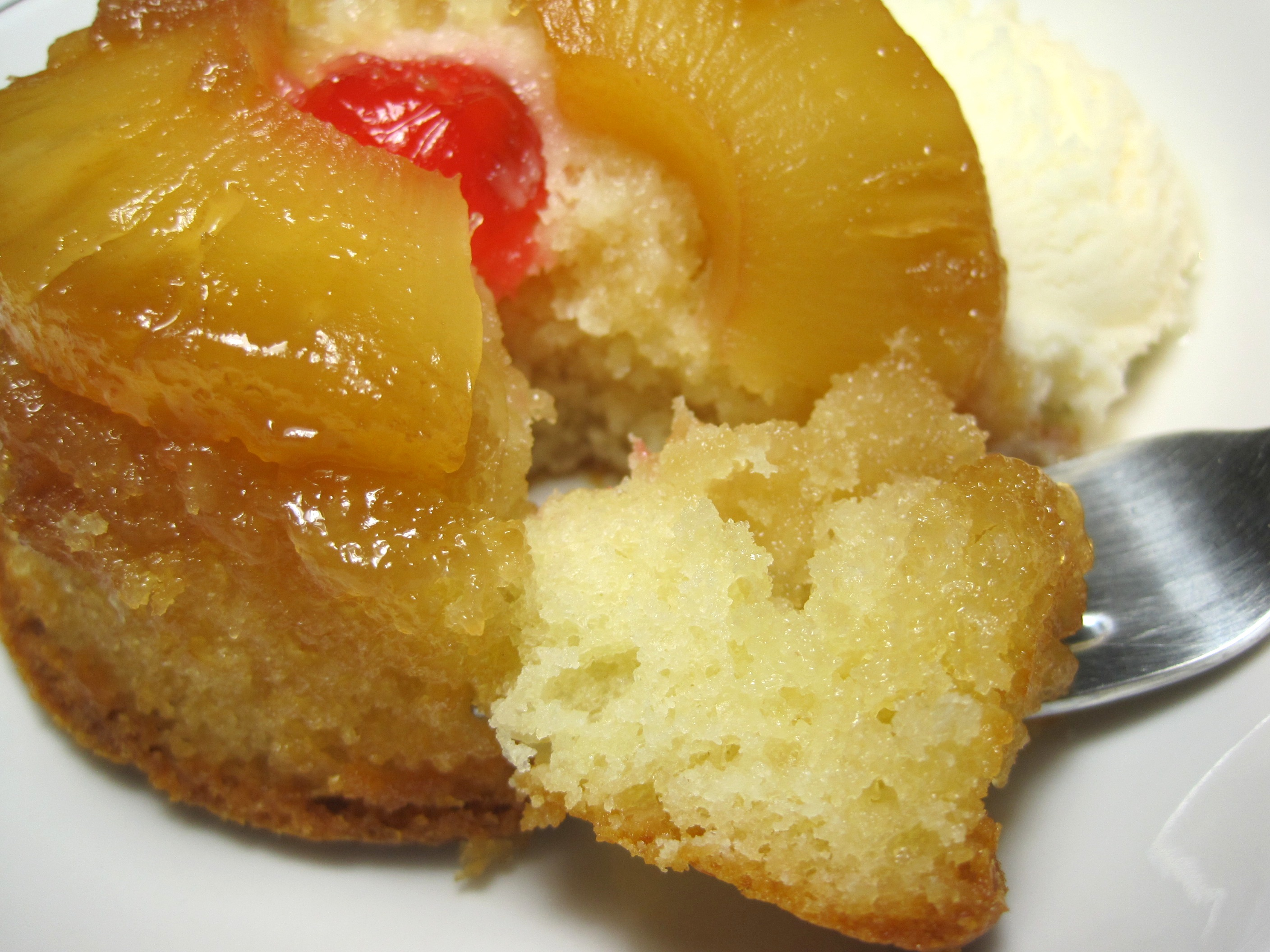 fork taking a piece of a Mini Pineapple Upside Down Cake