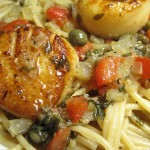 Scallop on pasta close up