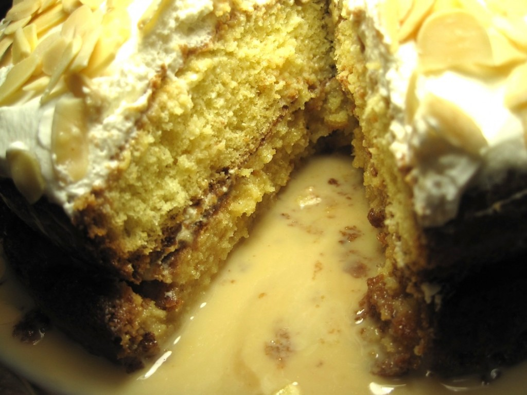 Tres Leches Cake with Dulce de Leche piece missing