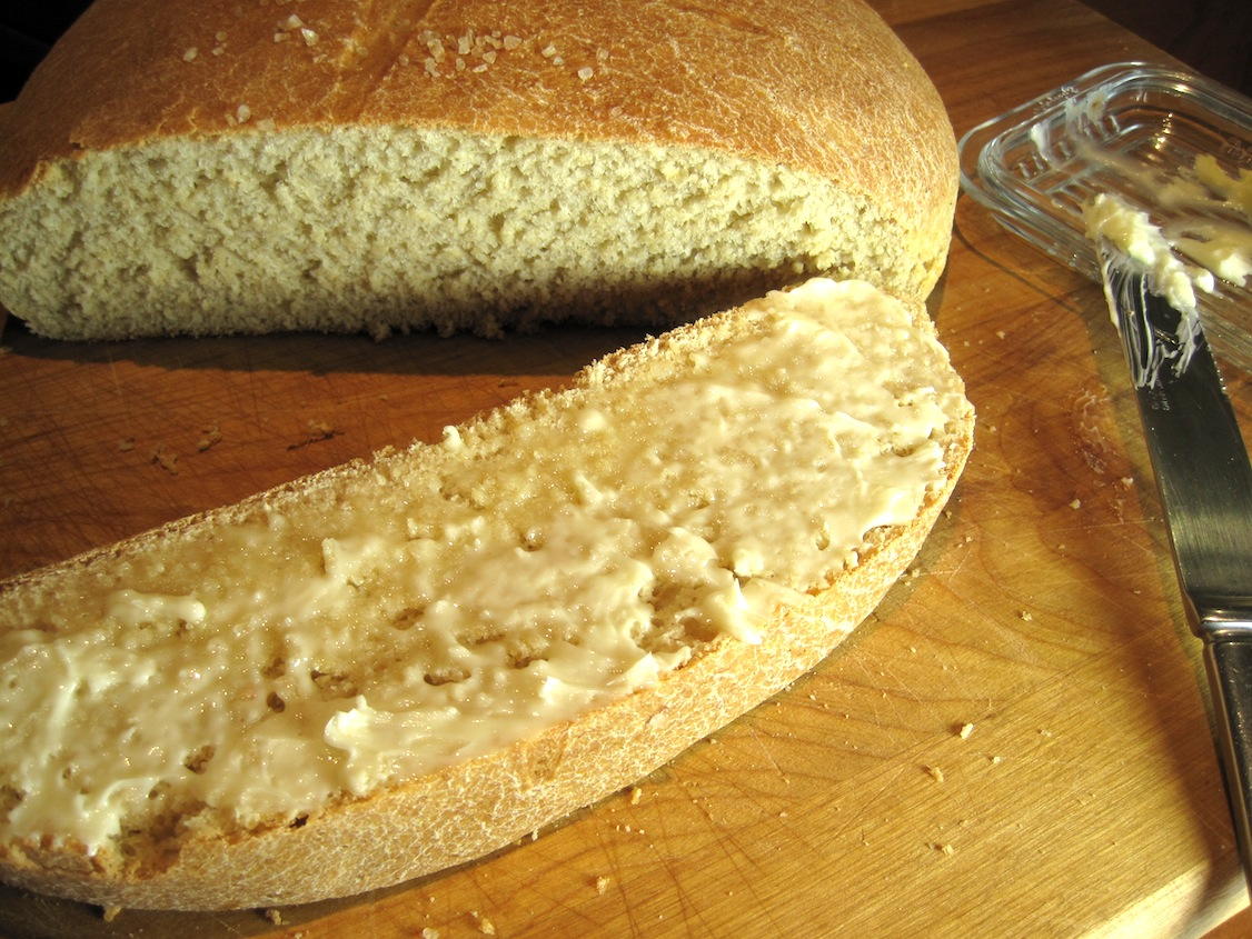 Sourdough Wheat Bread, sliced with butter on it