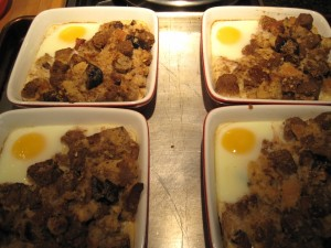 French Toast Bread Puddings on baking sheet in the oven