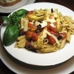 Whole Wheat Penne Pasta with fresh tomatoes, basil, garlic, Kalamata olives and artichokes