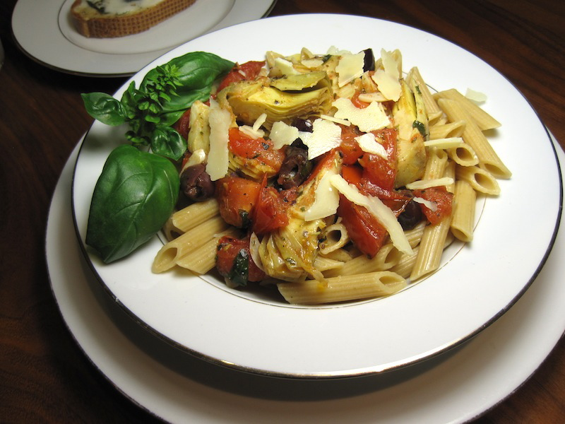 Whole Wheat Penne Pasta with fresh tomatoes, basil, garlic, Kalamata olives and artichokes
