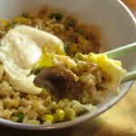 Chicken Fried Rice topped with a poached egg with broken yolk