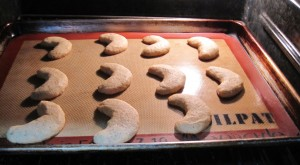 Almond Crescent Cookies baking in the oven.