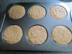 Muffin mix in the muffin top pan