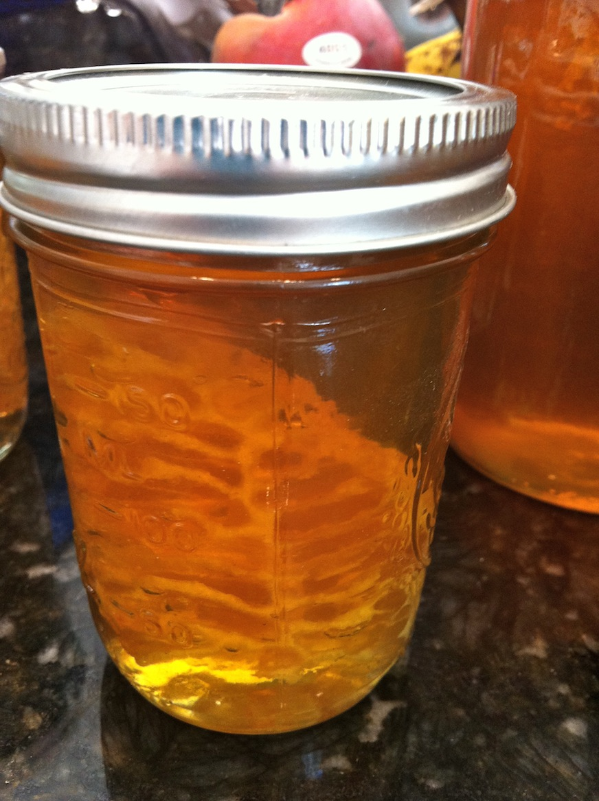 Small jar of fresh honey with comb