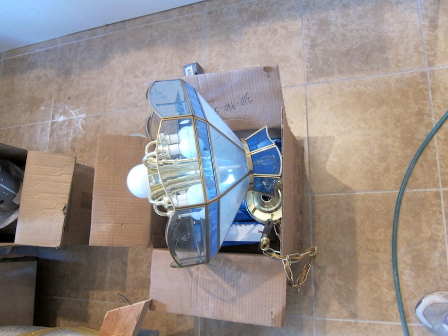 Out with the old light fixture that was over the eating area...
