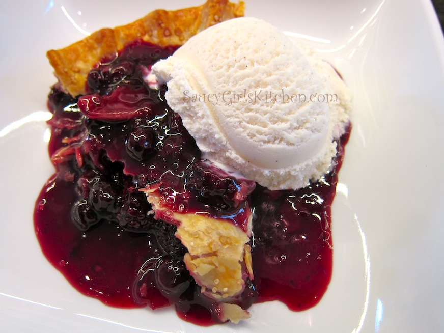 Slice of Warm Blueberry Pie with Vanilla Ice Cream