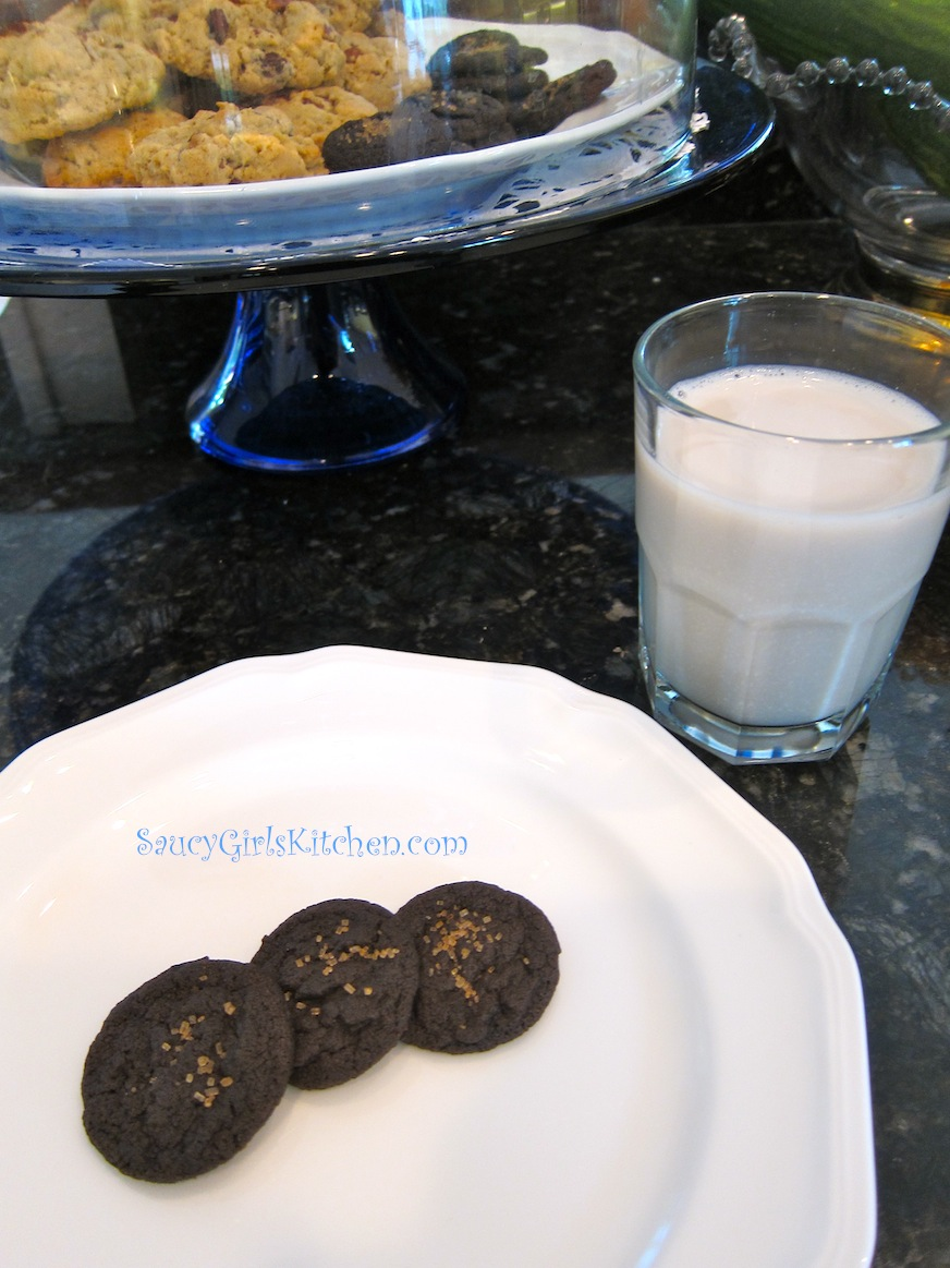 Chocolate Cookies on a plate with glass of Almond Milk