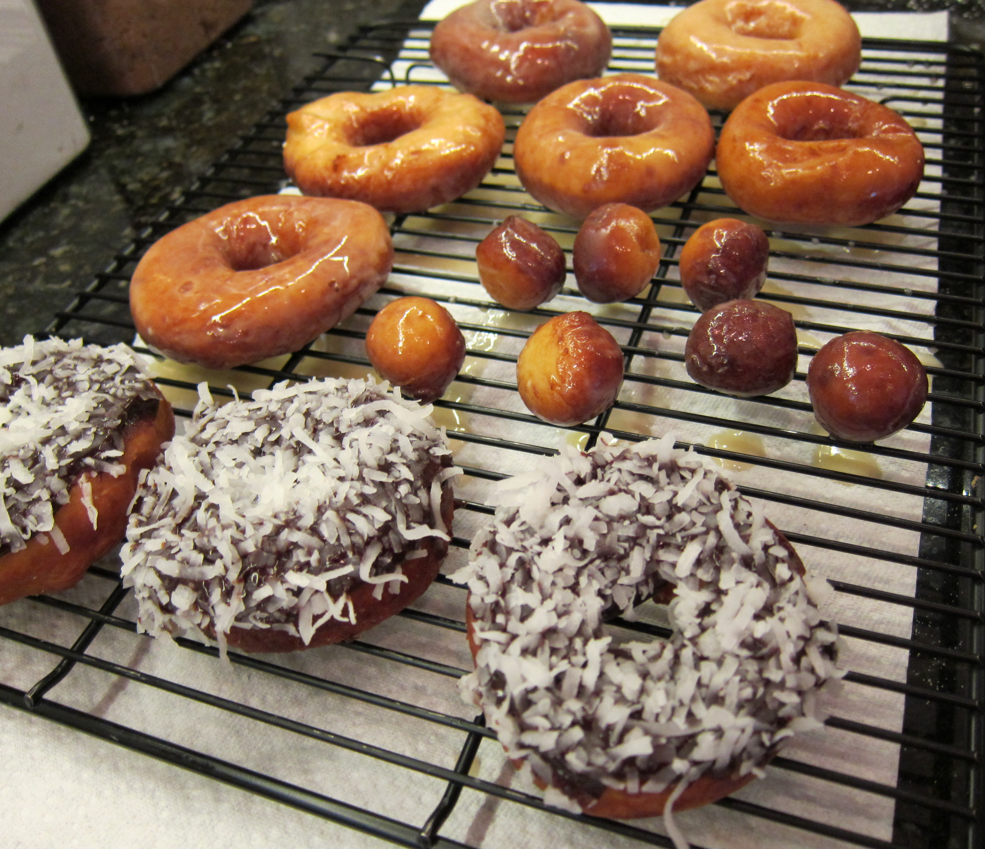 fresh homemade donuts on the baking rack