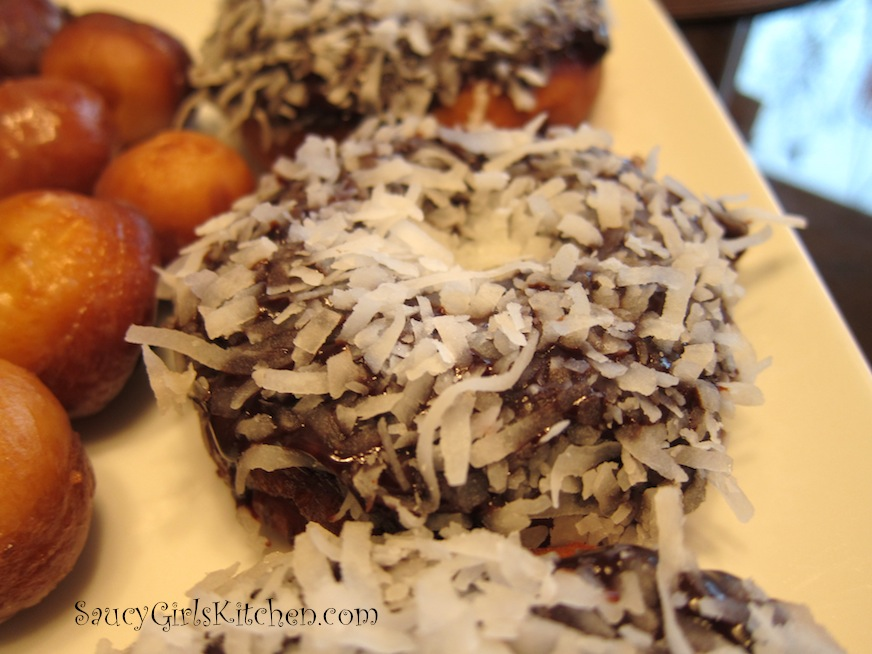 fresh homemade donuts with chocolate and coconut topping
