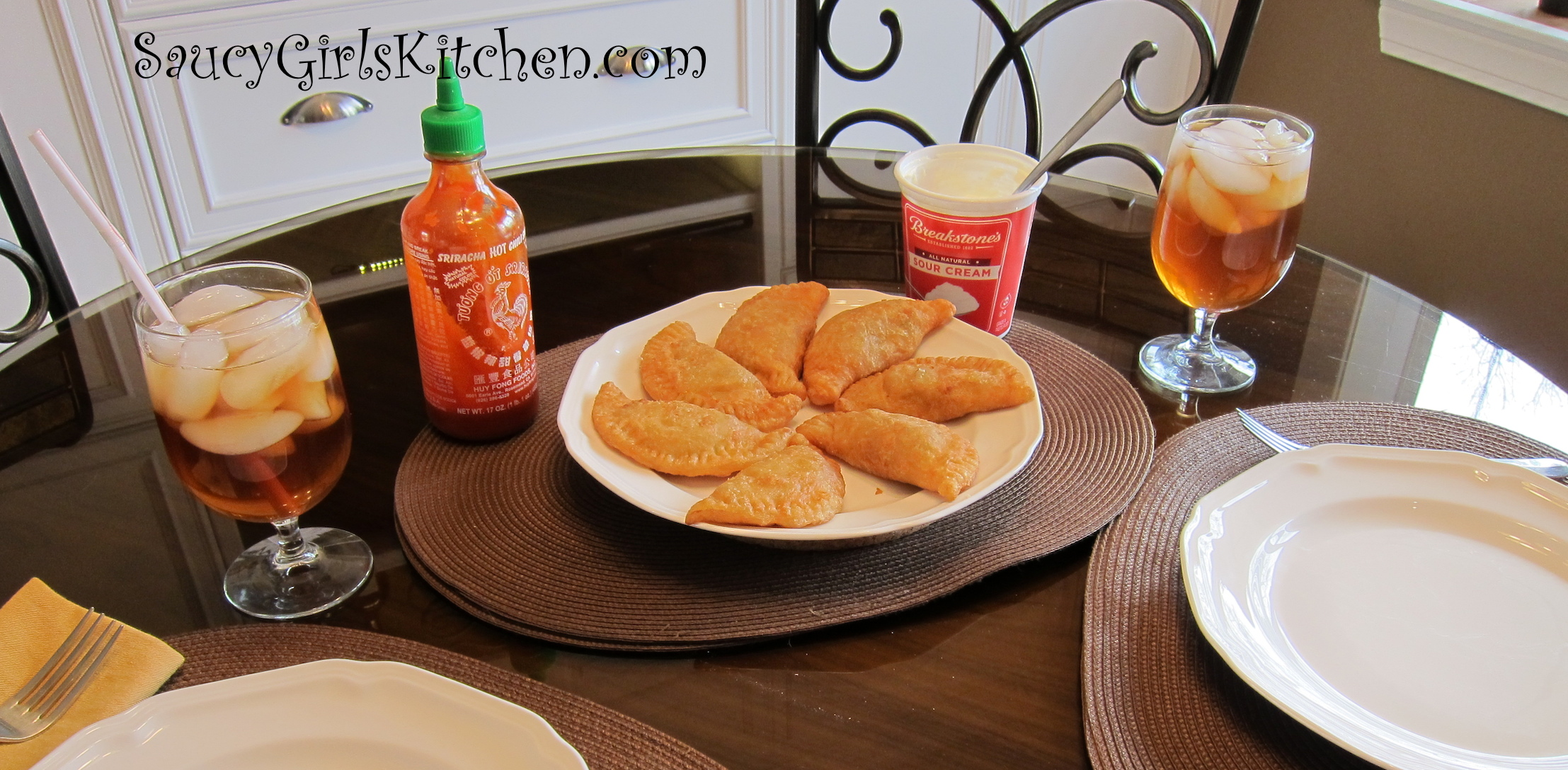 Beef Empanadas with Sour Cream and Sriracha Sauce