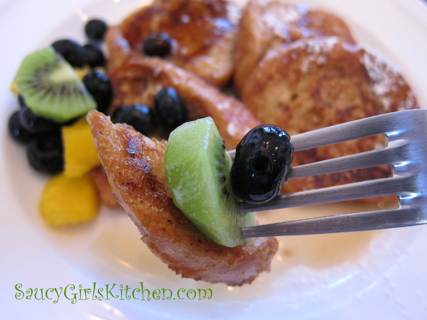 Taking a bite of French Toast with Fruit